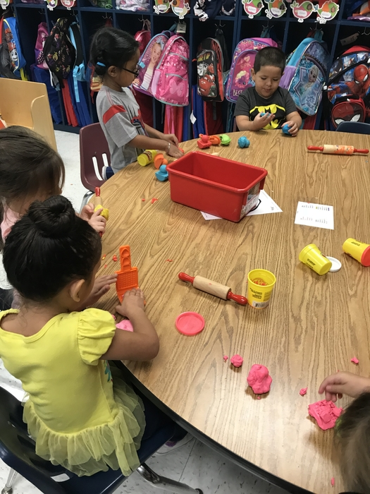 Pre-k students learning through play.