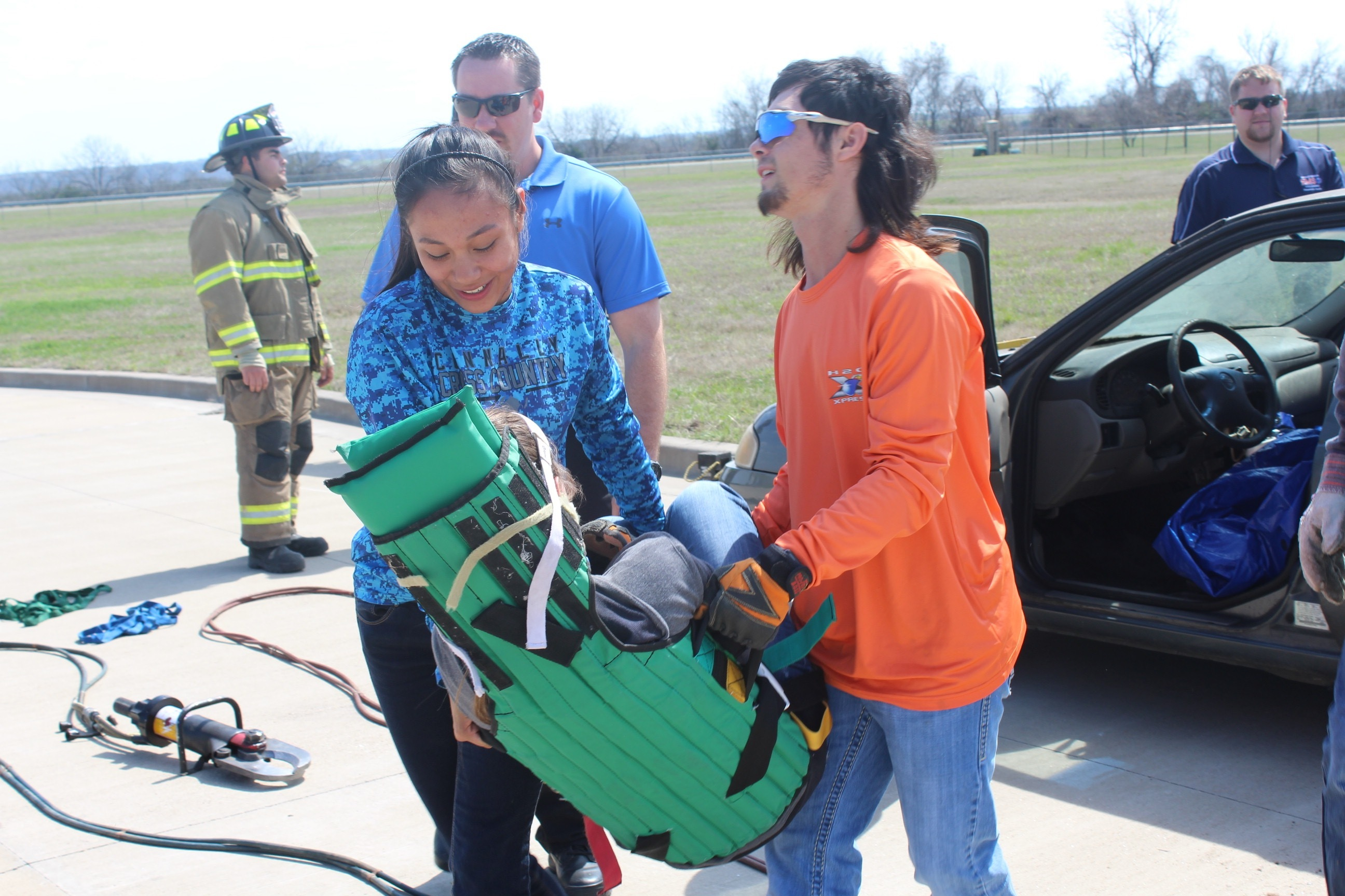 Hannah Fragag and Chandler Anderson participating in an EMT demonstration