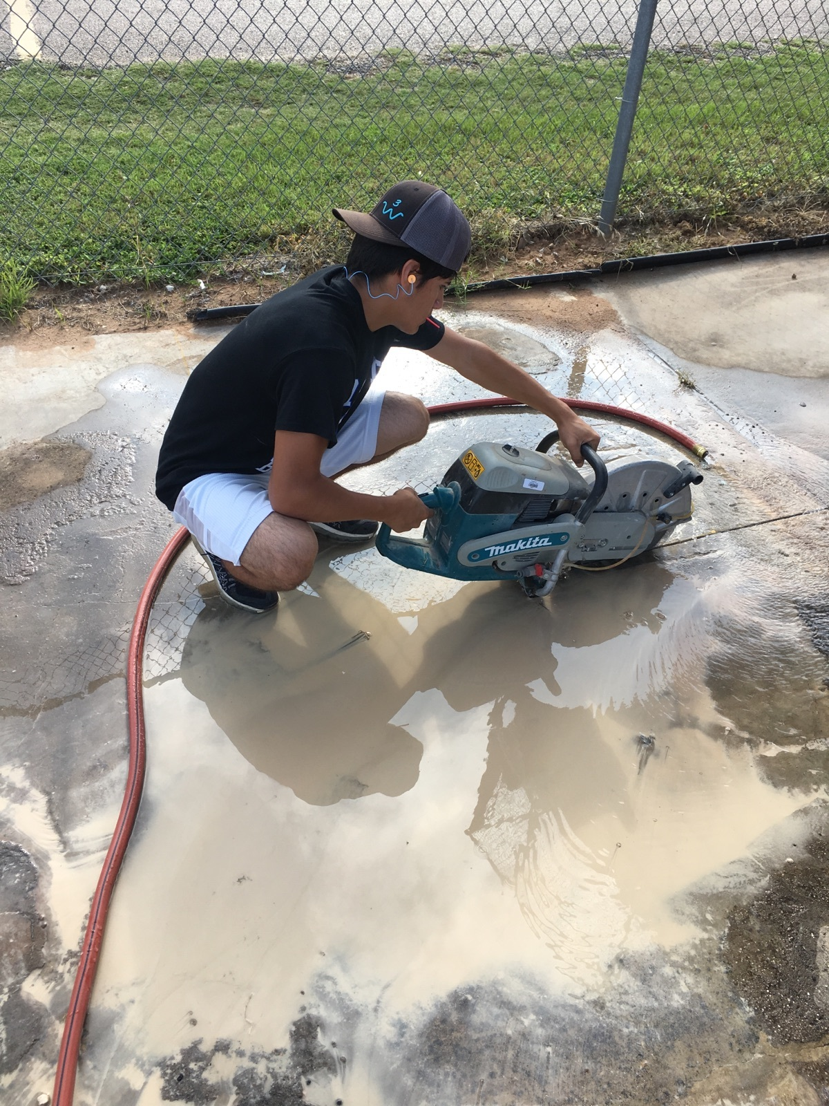 Anthony participating in a summer internship with the Maintenance Department
